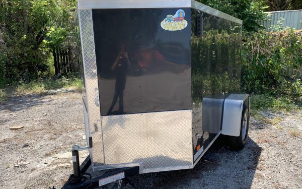 USED COVERED WAGON 5 X 8 ENCLOSED TRAILER