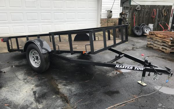 Master tow 5x10 Utility full tilt
